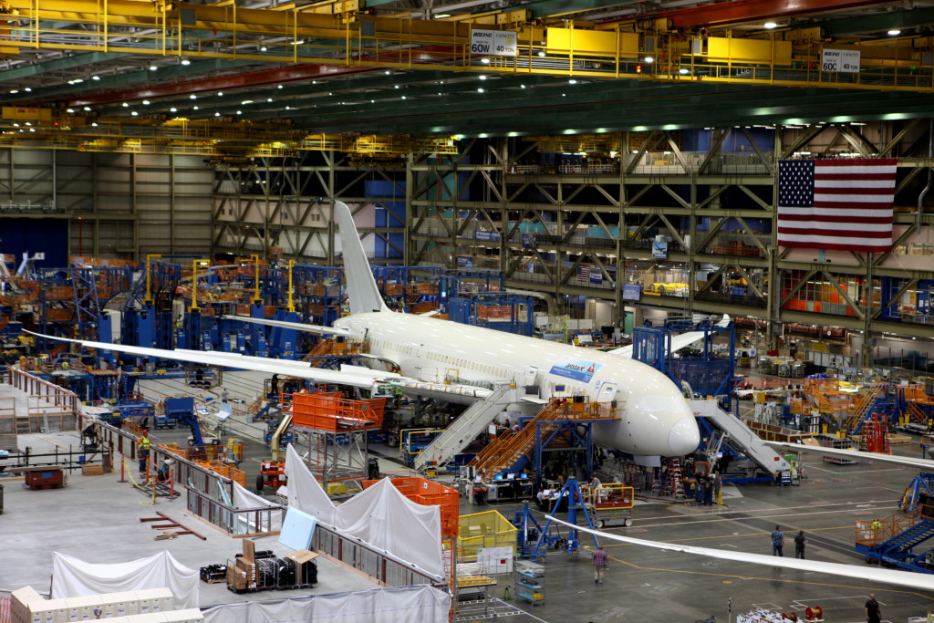 An aircraft on an assembly line. EMA consulting services for e3, emc/emi, RF, and radiation hardening
